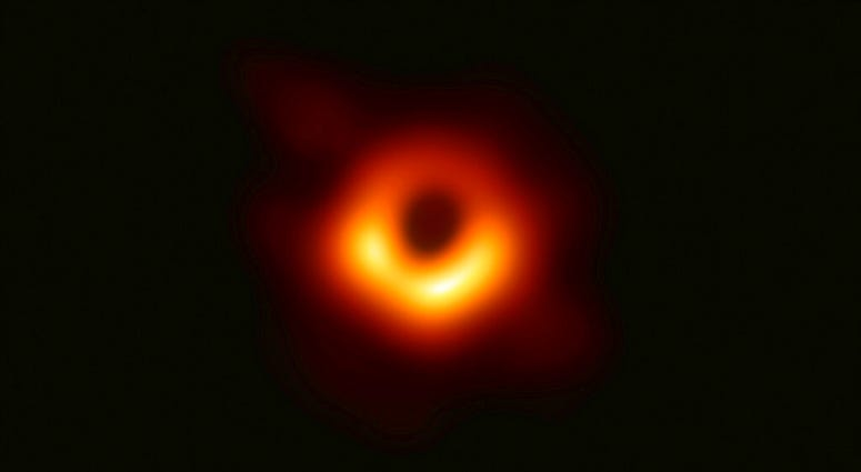 This image released Wednesday, April 10, 2019, by Event Horizon Telescope shows a black hole. (Event Horizon Telescope Collaboration/Maunakea Observatories via AP)