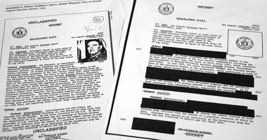 The redacted, right, and the unredacted versions of the biographical intelligence file report on Chilean dictator Augusto Pinochet from 1975 is photographed on April 15, 2019, in Washington. (AP Photo/Jon Elswick)