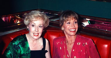 "FILE - In this Aug. 30, 1992, file photo, Mary Tyler Moore, right, is joined by former ""Mary Tyler Moore Show"" co-star Georgia Engel, left. (AP Photo/Malcolm Clarke, File)"