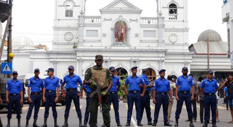 Sri Lankan Army soldiers secure the area around St. Anthony's Shrine after a blast in Colombo, Sri Lanka, Sunday, April 21, 2019. A Sri Lanka hospital spokesman says several blasts on Easter Sunday have killed dozens of people. (AP Photo/Eranga Jayawarden