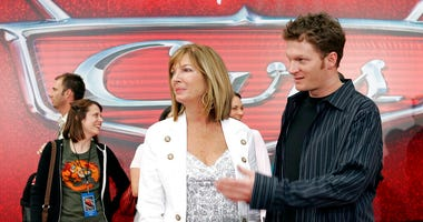 "FILE - In this May 26, 2006, file photo, NASCAR driver Dale Earnhardt Jr., right, and his mother Brenda Jackson, front left, arrive for the premiere of the Disney/Pixar animated film ""Cars"" at Lowe's Motor Speedway in Concord, N.C.  (AP Photo/Chuck Burton"