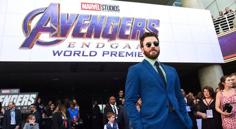 """Chris Evans arrives at the premiere of """"Avengers: Endgame"""" at the Los Angeles Convention Center on Monday, April 22, 2019. (Photo by Chris Pizzello/Invision/AP)"""