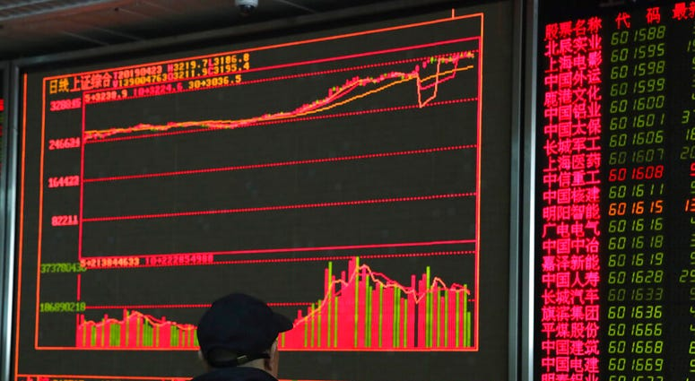 An investor monitors prices at a stock brokerage in Beijing on Tuesday, April 23, 2019.  (AP Photo/Ng Han Guan)