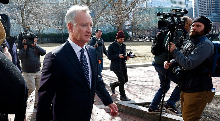 FILE - In this April 3, 2019 file photo, TobyMacFarlane departs federal court in Boston after facing charges in a nationwide college admissions bribery scandal.  (AP Photos/Michael Dwyer, File)