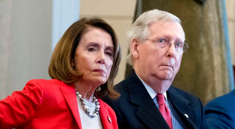 March 21, 2018, file photo Nancy Pelosi of Calif., and Senate Majority Leader Mitch McConnell of Ky., attend a Congressional Gold Medal Ceremony