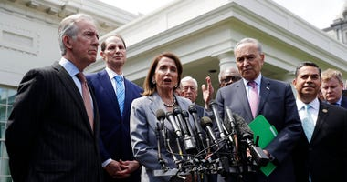 Speaker of the House Nancy Pelosi of Calif. and Senate Minority Leader Sen. Chuck Schumer of N.Y. and other Democrats, walk out to talk to the media after meeting with President Donald Trump.  (AP Photo/Evan Vucci)