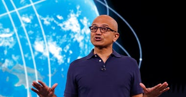 Microsoft CEO Satya Nadella delivers the keynote address at Build, the company's annual conference for software developers Monday, May 6, 2019, in Seattle. (AP Photo/Elaine Thompson)