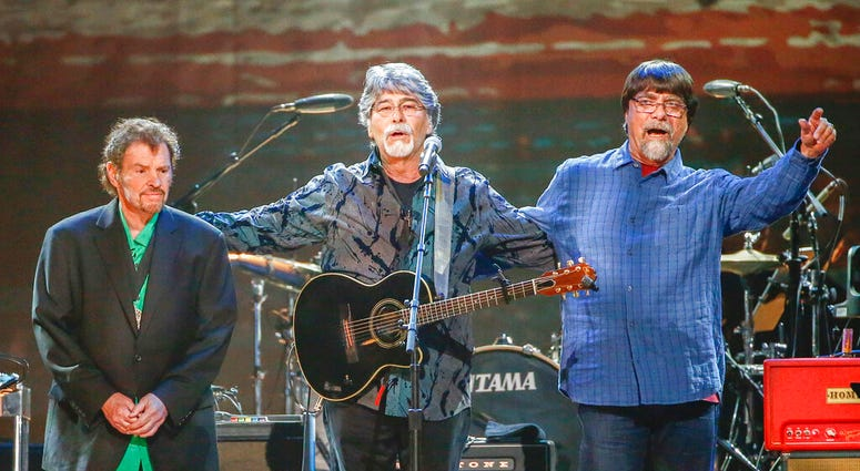 FILE - This April 6, 2017 file photo shows Jeff Cook, from left, Randy Owen, and Teddy Gentry from the band Alabama performing at the Bridgestone Arena in Nashville, Tenn.  (Photo by Al Wagner/Invision/AP, File)