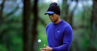 Tiger Woods flips his ball as he walks along the ninth green during a practice round for the PGA Championship golf tournament, Monday, May 13, 2019, in Farmingdale, N.Y. (AP Photo/Julie Jacobson)