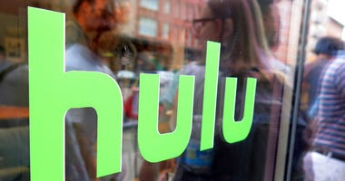 FILE - This June 27, 2015, file photo, shows the Hulu logo on a window at the Milk Studios space in New York.  (AP Photo/Dan Goodman, File)