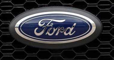In this Feb. 17, 2019, file photo the company logo is displayed on the grille of an unsold 2019 F150 pickup truck at a Ford dealership in Broomfield, Colo.  (AP Photo/David Zalubowski, File)