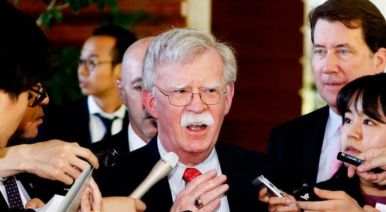 FILE - In this Friday, May 24, 2019, file photo, U.S. National Security Adviser John Bolton is surrounded by reporters at the prime minister's official residence in Tokyo, Japan. (Yohei Kanasashi/Kyodo News via AP, File)