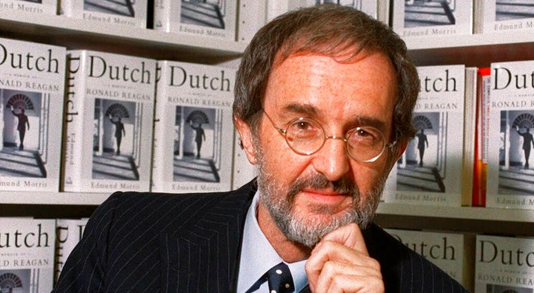 """FILE - In this Wednesday, Sept. 29, 1999, file photo, Edmund Morris, author of """"Dutch: A Memoir of Ronald Reagan,"""" poses at Random House in New York. (AP Photo/Marty Lederhandler, File)"""