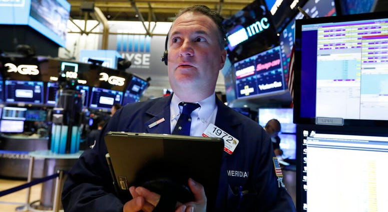 Trader Jonathan Corpina works on the floor of the New York Stock Exchange, Wednesday, May 29, 2019. Stocks are getting off to a weak start on Wall Street led by drops in technology and health care companies. (AP Photo/Richard Drew)