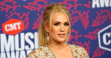 Carrie Underwood, left, accepts the award for female video of the year from presenter Trisha Yearwood at the CMT Music Awards on Wednesday, June 5, 2019, at the Bridgestone Arena in Nashville, Tenn. (AP Photo/Mark Humphrey)