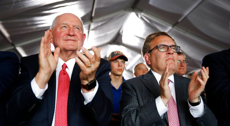 Agriculture Secretary Sonny Perdue, left, and Environmental Protection Agency Administrator Andrew Wheeler applaud as they listen to President Donald Trump speak. (AP Photo/Patrick Semansky)