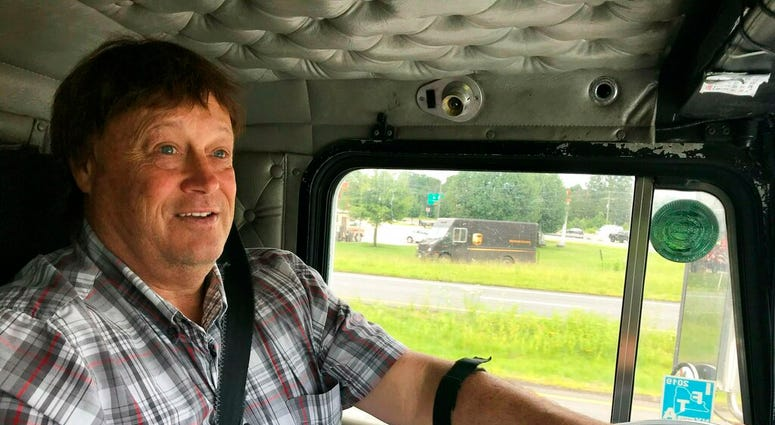 Truck driver Terry Button drives his truck near Opal, Va., Thursday, June 13, 2019. (AP Photo/Tom Sampson)