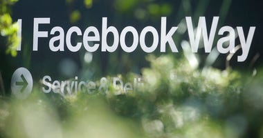 FILE - In this April 25, 2019, file photo an address sign for Facebook Way is shown in Menlo Park, Calif. Facebook unveiled a broad plan Tuesday, June 18, to create a new digital currency. (AP Photo/Jeff Chiu, File)