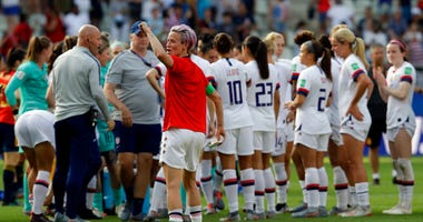 United States'Megan Rapinoe, front, celebrates at the end of the Women's World Cup round of 16 soccer match between Spain and US at the Stade Auguste-Delaune in Reims, France. (AP Photo/Alessandra Tarantino)