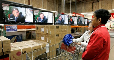 "FILE - In this Feb. 22, 2009, file photo shoppers watch the television show ""The Office"" as they compare wide screens on display at Costco in Mountain View, Calif.  (AP Photo/Paul Sakuma, File)"