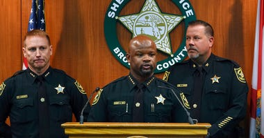 Broward Sheriff Gregory Tony, center, announces that two additional deputies have been fired as a result of the agency's internal affairs investigation into the mass shooting at Marjory Stoneman Douglas High School in Parkland. (Joe Cavaretta/South Florid