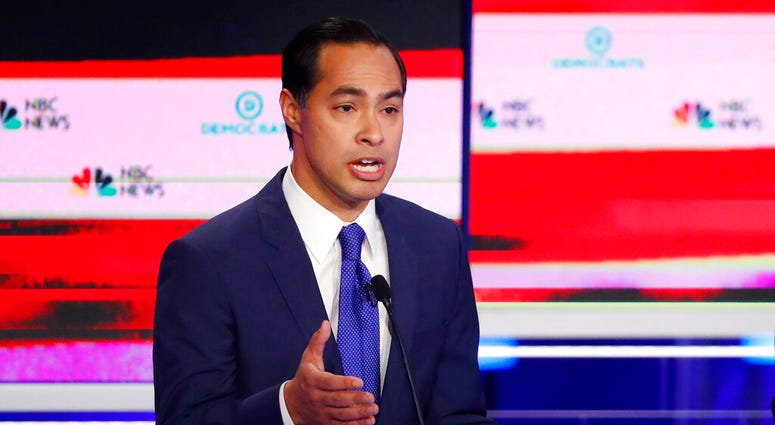Democratic presidential candidate former Housing and Urban Development Secretary Julian Castro gestures during a Democratic primary debate hosted by NBC News.  (AP Photo/Wilfredo Lee)
