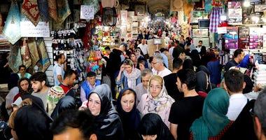 eople shop at the old main bazaar in Tehran, Iran, Tuesday, July 2, 2019.  (AP Photo/Ebrahim Noroozi)