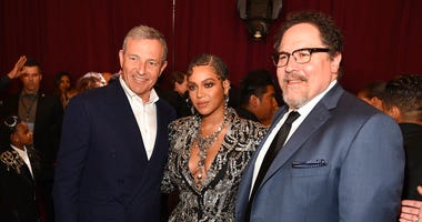"""Bob Iger, left, chairman and CEO of The Walt Disney Company, poses with """"The Lion King"""" cast member Beyonce, center, and the film's director Jon Favreau at the premiere of the film. (Photo by Chris Pizzello/Invision/AP)"""