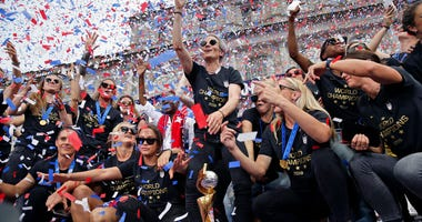 The U.S. women's soccer team, Megan Rapinoe center, celebrates at City Hall after a ticker tape parade, Wednesday, July 10, 2019, in New York. (AP Photo/Seth Wenig)