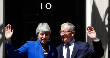 Britain's Prime Minister Theresa May and her husband Philip waves from the steps of 10 Downing Street, London.   (AP Photo/Frank Augstein)