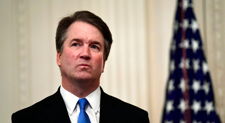 FILE - In this Oct. 8, 2018, file photo, Supreme Court Justice Brett Kavanaugh stands before a ceremonial swearing-in in the East Room of the White House in Washington. (AP Photo/Susan Walsh, File)