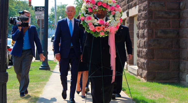 Former Vice President and presidential candidate Joe Biden, center left, joins Sen. Doug Jones and Birmingham Mayor Randall Woodfin at a wreath laying after a service at 16th Street Baptist Church in Birmingham, Ala. (Ivana Hrynkiw/The Birmingham News via