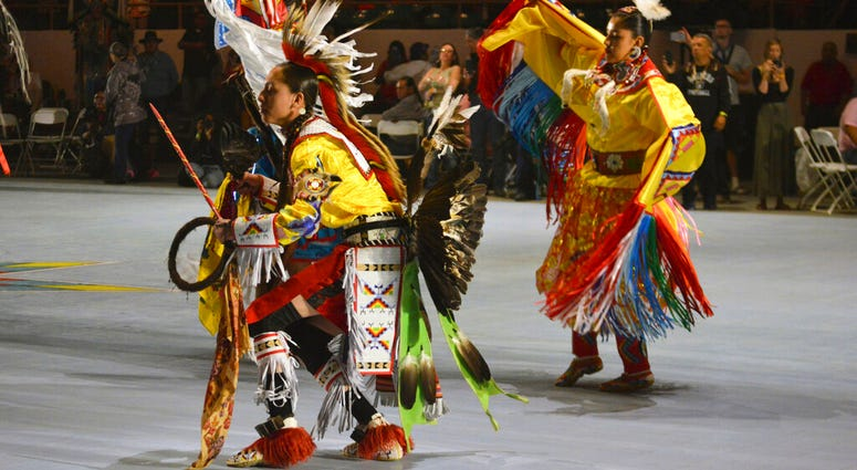 FILE - In this April 27, 2019 file photo, dancers enter at the Gathering of Nations, one of the world's largest gatherings of indigenous people in Albuquerque, N.M.  (AP Photo/Russell Contreras, File)