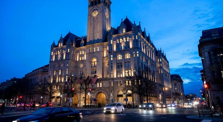 FILE - In this Jan. 23, 2019, file photo, the Trump International Hotel near sunset in Washington. (AP Photo/Alex Brandon, File)