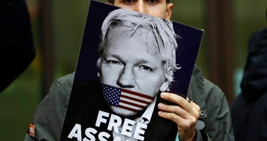 Supporters of Wikileaks founder Julian Assange demonstrate outside Westminster Magistrates' Court in London where Assange is expected to appear as he fights extradition to the United States. (AP Photo/Kirsty Wigglesworth)