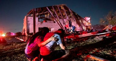 In this Sunday, Oct. 20, 2019 photo, Henry Ramirez, a member of Primera Iglesia Dallas, is consoled by his mother Maribel Morales as they survey severe damage to the church. (AP Photo/Jeffrey McWhorter)
