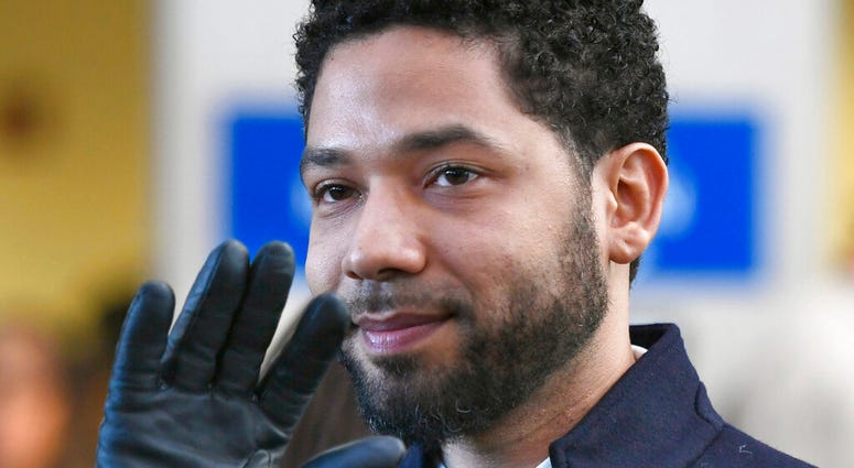 FILE - In this March 26, 2019 file photo, actor Jussie Smollett smiles and waves to supporters before leaving Cook County Court after his charges were dropped in Chicago. (AP Photo/Paul Beaty, File)