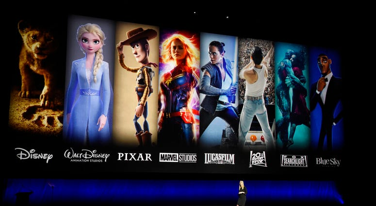 FILE - In this April 3, 2019, file photo characters from Disney and Fox movies are displayed. (Photo by Chris Pizzello/Invision/AP, File)