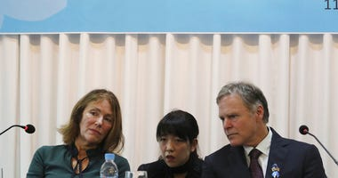 Fred Warmbier, right, and his wife Cindy listen on about their son Otto Warmbier who died after being released by North Korea in 2017 during a press conference in Seoul, South Korea, Friday, Nov. 22, 2019. (AP Photo/Ahn Young-joon)