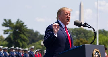 FILE - In this July 25, 2019, file phot, President Donald Trump speaks during a ceremony for new Secretary of Defense Mark Esper at the Pentagon.