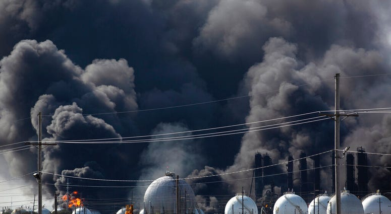 Smoke from an explosion at the TPC Group plant is seen Wednesday, Nov. 27, 2019, in Port Neches, Texas. Two massive explosions 13 hours apart tore through the chemical plant Wednesday, and one left several workers injured.