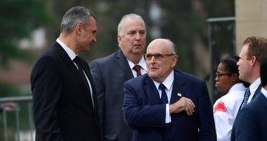 FILE - In this Saturday, Sept. 1, 2018 file photo, President Trump's attorney Rudy Giuliani, center, talks with Ukrainian boxing champ Wladimir Klitschko, left, as they arrive to attend a memorial service for Sen. John McCain, R-Ariz. (AP Photo/Susan Wals