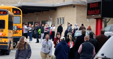 Waukesha South High School students find their waiting parents and friends and hug after they leave the building following shots fired inside the school, Monday, December 2, 2019.