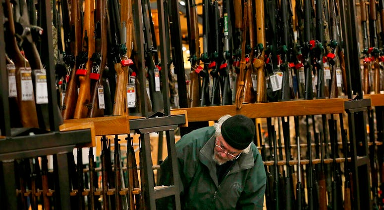 In this Nov. 29, 2019, file photo, a man looks at the shotgun section of Cabela's while shopping on Black Friday in Hazelwood, Mo. (Christian Gooden/St. Louis Post-Dispatch via AP)