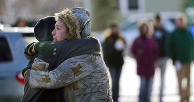 Sarah Rogstad, right, hugs Morgan Rogstad, grade 9, after being reunited at the Tipler Middle school reunification center on Tuesday December 3, 2019, in Oshkosh, Wis. (Wm. Glasheen/The Post-Crescent via AP)