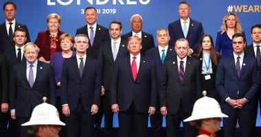 From front row left, British Prime Minister Boris Johnson, NATO Secretary General Jens Stoltenberg, U.S. President Donald Trump, Turkish President Recep Tayyip Erdogan and Spanish Prime Minister Pedro Sanchez attend a ceremony event.   (AP Photo/Francisco