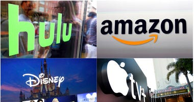 This combination photo shows, clockwise from top left, the Hulu logo on a window at the Milk Studios space in New York, the Amazon logo in Santa Monica, Calif., the Apple TV+ logo displayed outside the Regency Village Theatre in Los Angeles.  (Curtis Comp