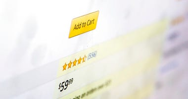 A customer rating for a product for sale on Amazon.com is displayed on a computer screen on Monday, Dec. 16, 2019, in New York.  (AP Photo/Jenny Kane)