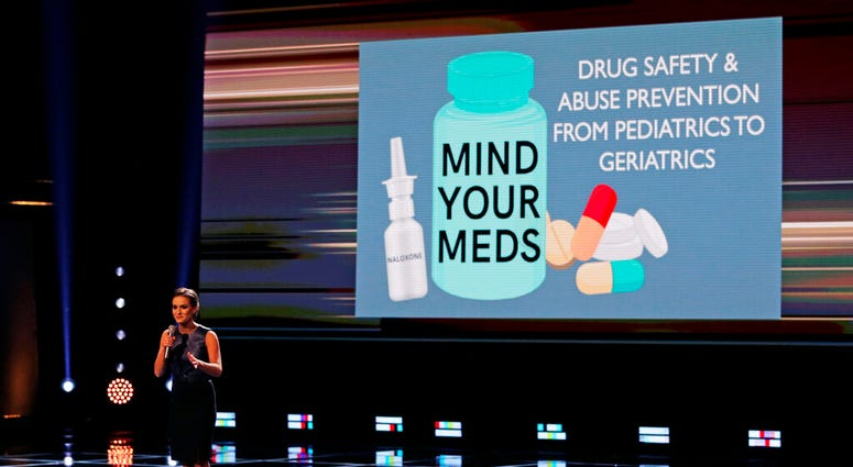 Camille Schrier, of Virginia, addresses her concern about drug safety to the audience prior to winning the Miss America competition at the Mohegan Sun casino in Uncasville, Conn., Thursday, Dec. 19, 2019.
