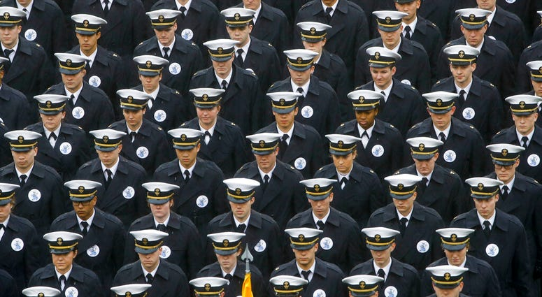 ILE - In this Dec. 14, 2019 file photo, Navy midshipmen march onto field ahead of an NCAA college football game between the Army and the Navy in Philadelphia.